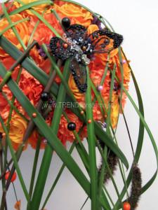 orange svart brudbukett närbild